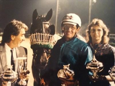 Anne Schlichtig, Tom Merriman and designer Roberto Cavalli with his horse in Italy