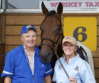 Dave Landry | Tom and June Durand and trotter Whiskey Tax finished second in the 2011 Hambletonian won by Broad Bahn. This week, Tom survived a plane crash on his farm.