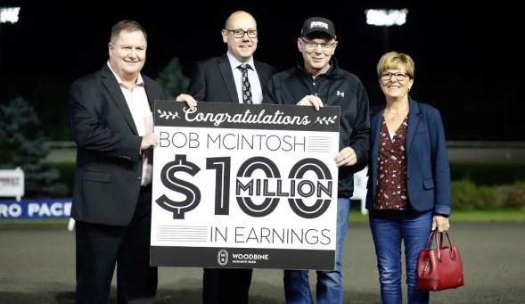 Dave Landry | In 2019, McIntosh surpassed $100 million in career trainer earnings and was congratulated by his wife, Patty and Woodbine Entertainment Group's Scott McKelvie (left) and Bill McLinchey (second from left).