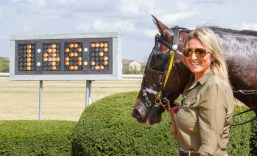 Nigel Soult | Elver Hanover with his co-owner Dr. Bridgette Jablonsky after setting a 1:48.3 2-year-old world record at Red Mile in 2019.