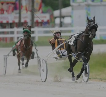 Dean Gillette | Doug Rideout, a perennial top driver and trainer on the Indiana fair circuit (shown racing at the Miami County Fair in 2019) sent out 10 winners on Friday.