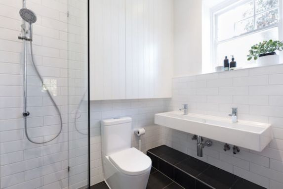 Add small ensuite bathroom with Harnett Renovations