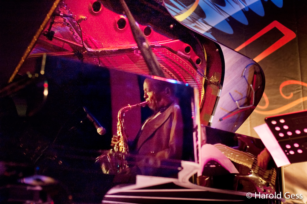 Barney Rachabane reflected in Darius Brubeck's Piano, Grahamstown 2010