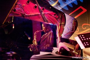 Barney Rachabane reflected in Darius Brubeck's Piano, Grahamstown 2010