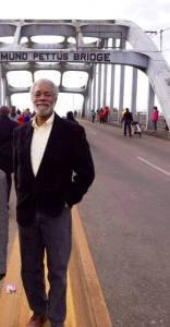 Harold Michael Harvey standing on sacred ground atop the Edmund Pettus Bridge in Selma, Alabama