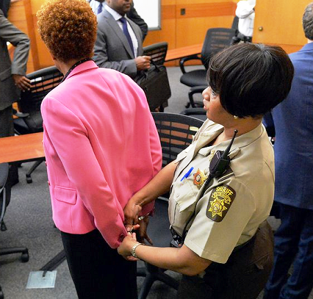 A former teacher in the Atlanta Public Schools is handcuffed and lead off to jail after a jury found her guilty of racketeering in a cheating scandal that  tarnished the Atlanta brand. Photo Credits: Atlanta Journal & Constitution