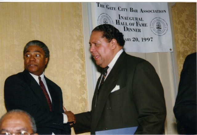 Harold Michael Harvey greeting the first black person elected mayor of a major southern city, Maynard Holbrook Jackson, at the Gate City Bar Association Banquet in 1997.  Photo Credits: The Harvey Law Firm