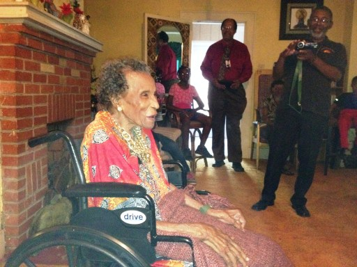 "Amelia Boynton Robinson hosted a Chew and Chat in her home on May 26, 2015. Harold Michael Harvey presented her with a copy of his new book ""Justice in the Round."" Photo Credits: (c) 2015 Cyn Harvey"