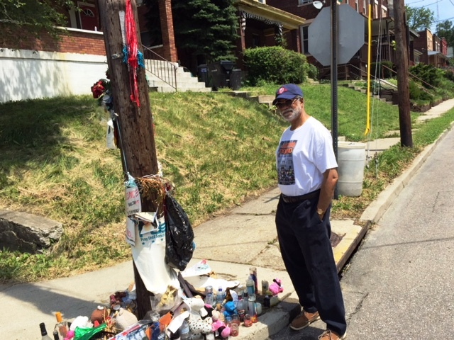 Harold Michael Harvey surveying a makeshift memorial at the intersection of Rice Street and Valencia Street in honor of Sam Dubose who was shot in the head by Ray Tensing of the University of Cincinnati Police Department on July 19, 2015. (c) 2015 Cascade Publishing House