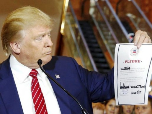 Donald Trump appears to smirk at his pledge not to run as an independent if he does not received the Republican nomination for president. Photo Credits: Reuter