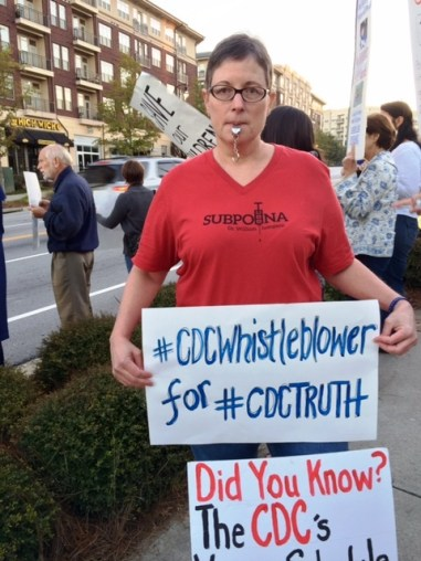 Marcella-Piper Terry protesting in front of the CDC demanding that the CDC tell the truth about the MMR Vaccine. October 23, 2015 Photo Credit: (c) 2015 Harold Michael Harvey
