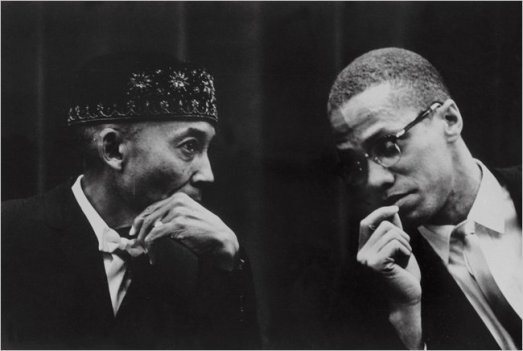 From L-R The Honorable Elijah Muhammad and Minister Malcolm X conferring before Malcolm was suspended from the Nation of Islam in November 1963. Photo Credits: face2faceafrica.com