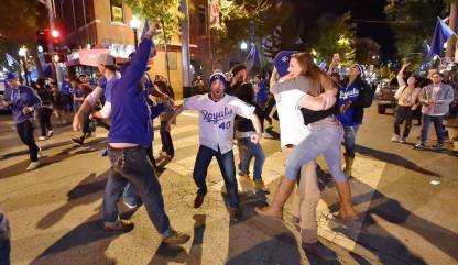 Kansas City Royals Fans celebrating in the streets after victory over the New York Mets in 2015 World Series. Photo Credits: Rich Sugg, Kansas City Star.com