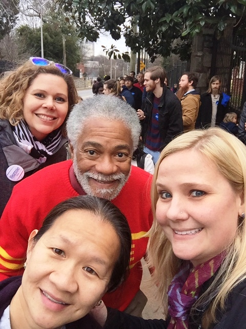 Harold Michael Harvey with Trinh Huynh and several of her friends taking a selfie while waiting for the doors of Forbes Arena at Morehouse College to open up for the Bernie Sanders HBCU Tour on February 16, 2016. Photo Credits: The Lady on the right.