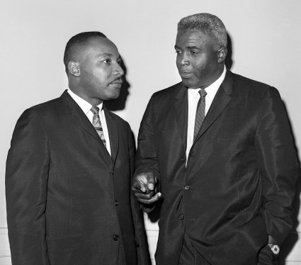 Jackie Robinson pictured in this photograph with Dr. Martin Luther King, Jr. was keenly aware of the role of the athlete in the cause of social justice. Photo Credit: www.rsvits.com