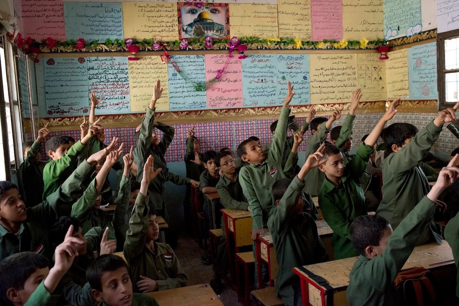 Yemeni boys raise their hands eagerly to answer a question in class. Their classroom in the Houthi-controlled area of Sa'ada is better supplied than most schools in Sana'a.