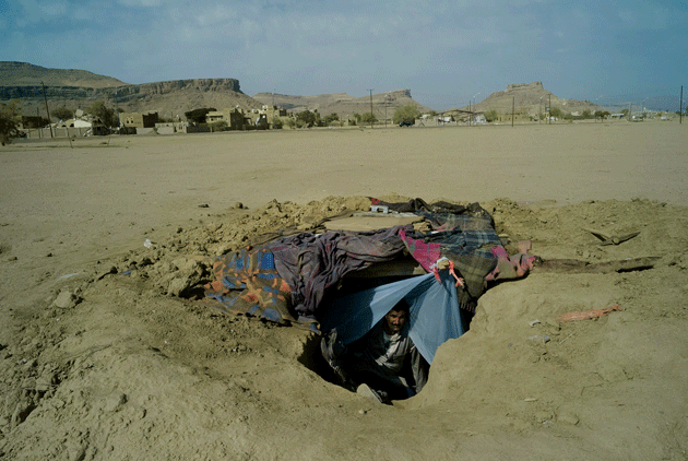 A man in an underground shelter on the outskirts of Saada city, which was hit by a series of Saudi-led air strikes in May 2015. Photograph by Maria Turchenkova.
