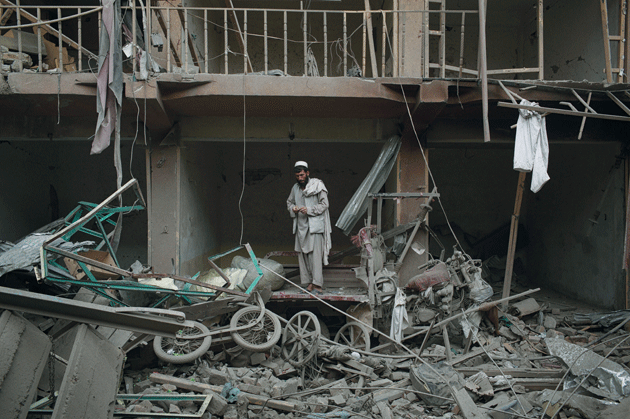 Rubble at the site of a truck bombing in eastern Kabul, August 7, 2015. The blast killed at least fifteen and injured hundreds of civilians; the target was believed to be a nearby military base. Two more major attacks occurred in the Afghan capital over the next twenty-four hours © Andrew Quilty/Oculi/Redux