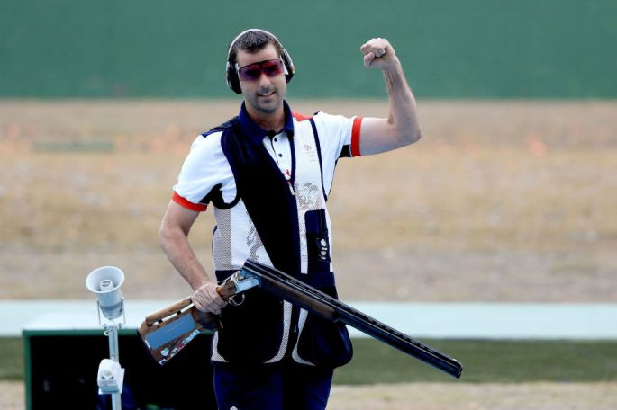 Day three: Ed Ling celebrates winning a bronze medal in the Men's Trap Event at the Olympic Shooting Centre.