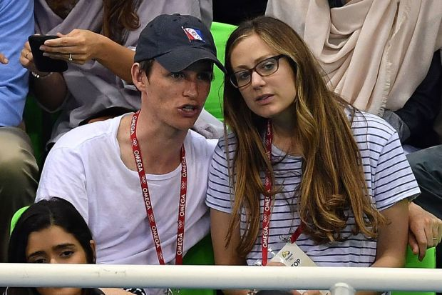 Day two: Eddie Redmayne and his wife Hannah Bagshawe watching the 100m Breaststroke.