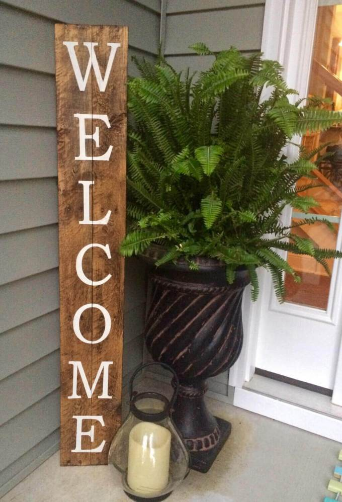 Farmhouse Porch Decorating Ideas - Storefront Style Wooden Welcome Sign - harpmagazine.com