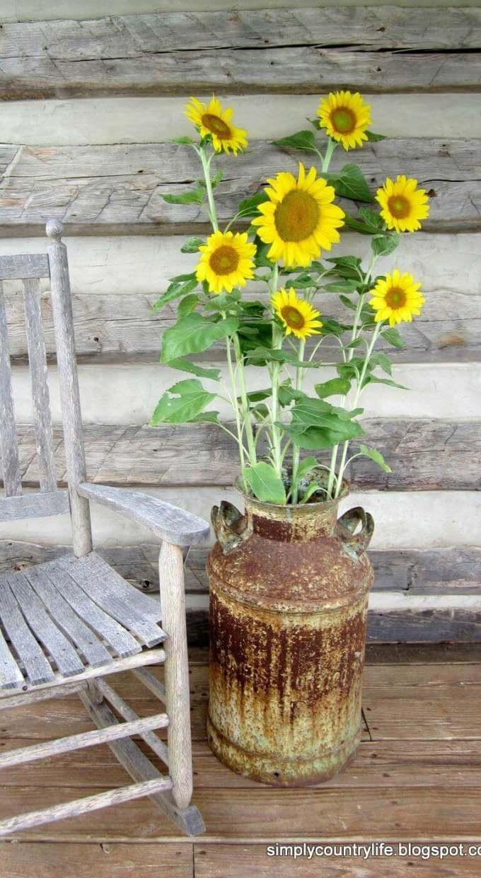 Farmhouse Porch Decorating Ideas - Rusted & Rustic Milk Pail Standing Vase - Harpmagazine.com