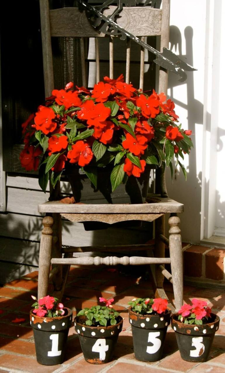 Front Door Flower Pots Ideas - Antique Chair with House Number Front Door Flower Pots - harpmagazine.com