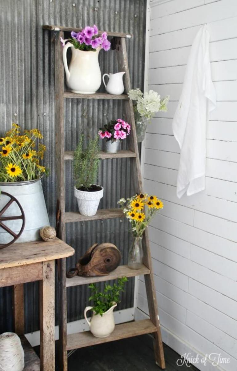 Farmhouse Porch Decorating Ideas - Painter's Ladder Potted Plant Stand - Harpmagazine.com