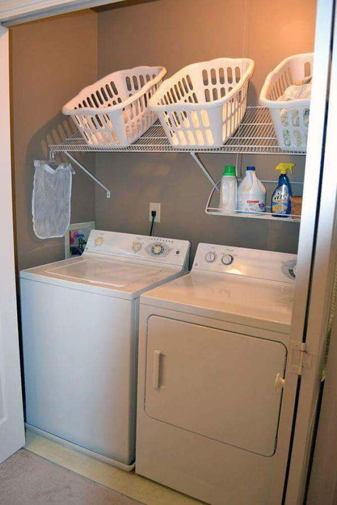 Storage Ideas for Small Spaces - Angled Shelving Conveniently Holds Laundry Baskets - Harpmagazine.com