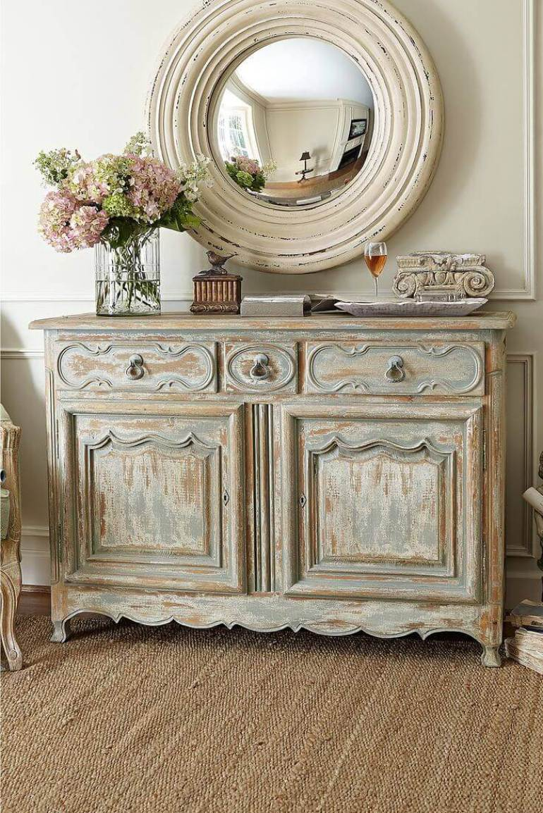 French Country Decor Ideas - Antiqued Credenza and Rustic Round Mirror - Harpmagazine.com