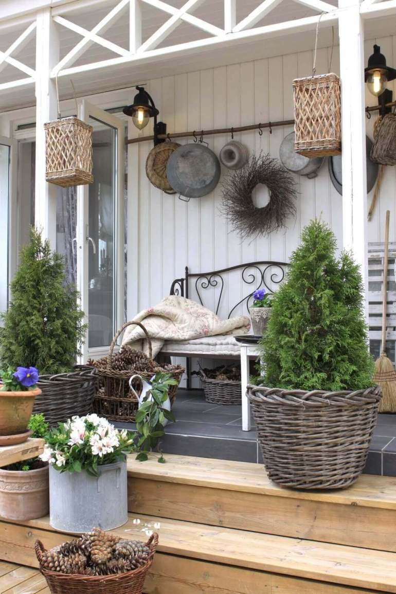 Farmhouse Porch Decorating Ideas - A Walk In The Woods Rustic Wicker & Pinecone Porch Decor - Harpmagazine.com