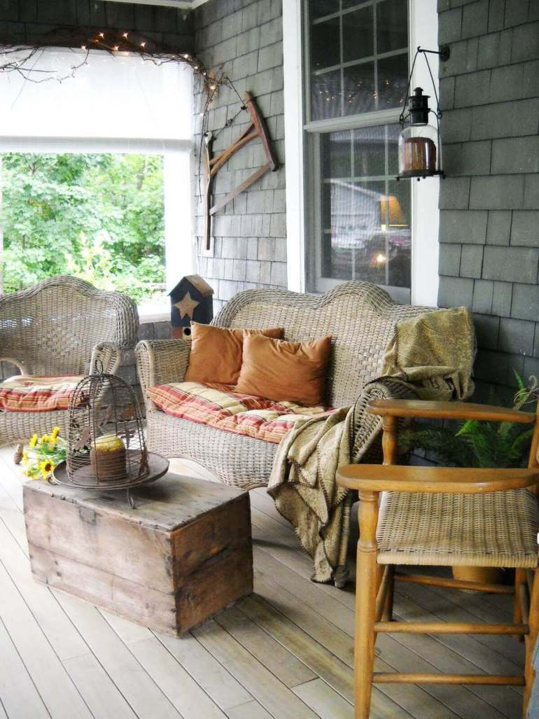 Farmhouse Porch Decorating Ideas - Mountain Cabin Woven Porch Furnishings With Antique Crate Table - Harpmagazine.com