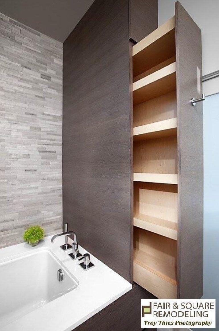 Storage Ideas for Small Spaces - Hidden Sliding Shelf in a Small Bathroom - Harpmagazine.com