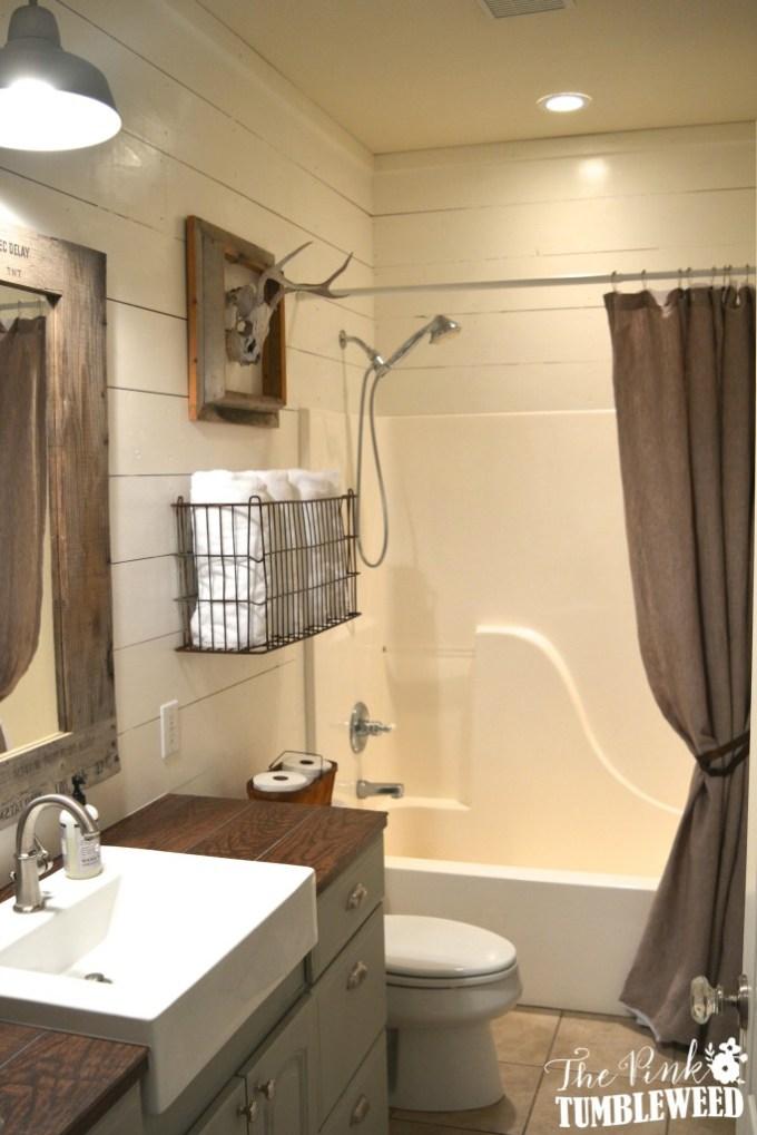 Rustic Bathroom Decor Ideas - Hunter's Bathroom Featuring Shiplap and Hunting Trophy - harpmagazine.com