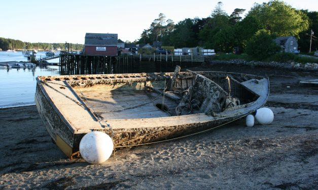 Salvaged boat removed from beach
