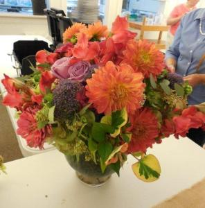 Sara used dahlias, roses and other seasonal flowers along with foliage from her own garden in this arrangement.