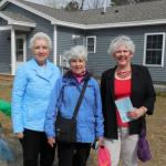 Suzanne Bushnell, Marcy McGuire, and Becky Gallery at Habitat for Humanity home dedication