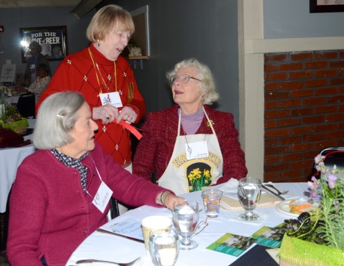 District Treasurer Martha Maguire chats with Harpswell member Janet Callowhill (seated, left) and Harpswell President Ann Standridge (right)