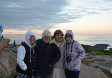 Early risers on Cadillac Mountain to see the sun rise over Frenchman's Bay