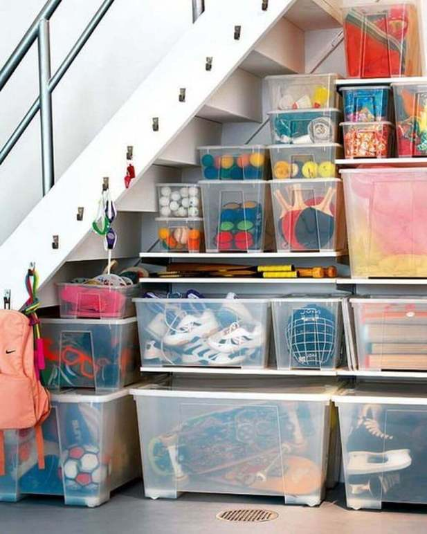 Simple under Stair Storage with Plastic Containers and Hangers