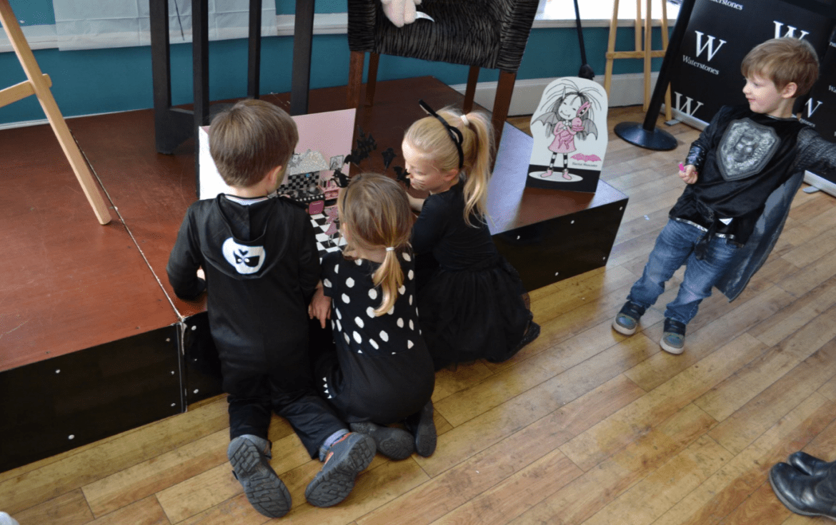 Children admiring Isadora Moon's kitchen at Manchester Waterstones Halloween Party