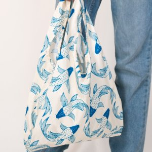 person holding kind bag koi fish design
