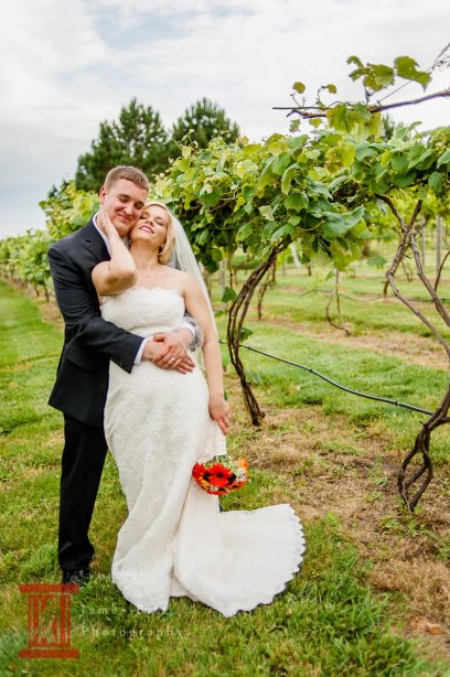 bride_and_groom_embracing_in_ a_vineyard_wedding_music_harris_academy_of_the_arts
