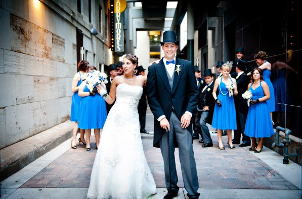 bride-and-groom-with-wedding-party-in-background