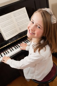 Girl At Piano Harris Academy of the Arts Piano Lessons