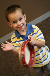 Kindermusik_boy_with_tambourine_lincoln_NE_harris_academy_of_the_arts