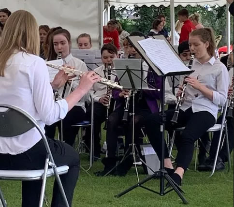 HMC Ensembles Chased Rain Clouds Away At Almsford Community Fun Day