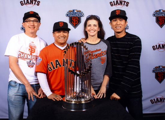 Posing with World Series trophies
