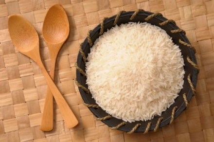600-06553482 © Jean-Christophe Riou Model Release: No Property Release: No Overhead View of Bowl of White Rice with Wooden Spoons