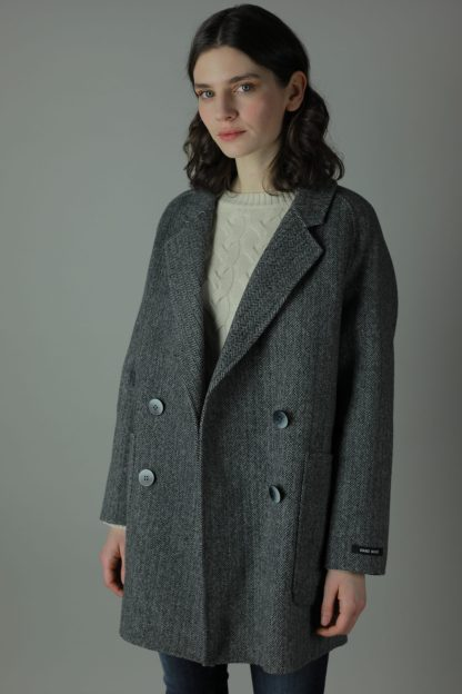 Luxurious style in our Ali Cashmere Coat for a year round look. Thigh length for casual wear, this coat features 100% Cashmere, loose fitting style and beautiful marble effect buttons. Twinning with our Ellie Cashmere Coat, The Ali coat is handmade for extra luxury just for you. Front view.